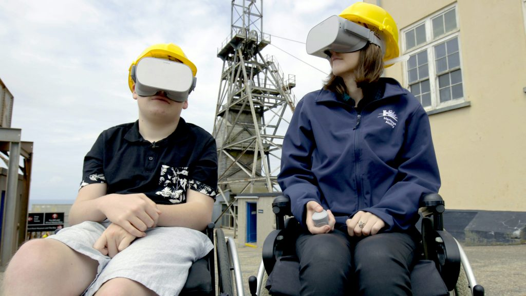 immersive technology - people using a VR tour at Geevor