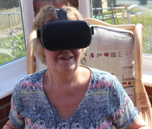 Stay at Home. Family member experiences the South West in virtual reality head set.