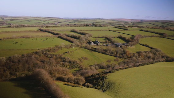 Views over Exmoor from a drone with fields and farm.