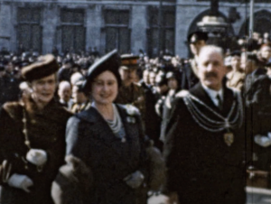 Screenshot of rare colour footage of Queen Elizabeth, the Queen Mother visiting Plymouth during the Blitz